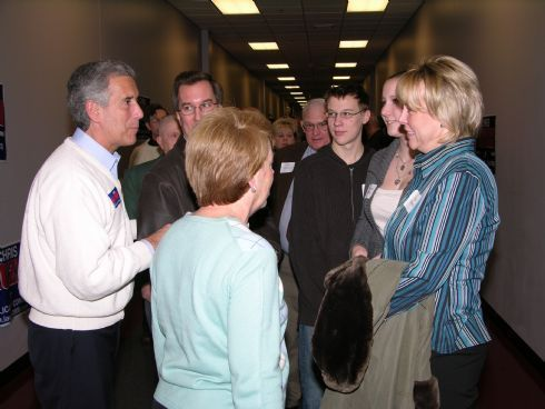 Chris and Sarah Lauzen at the front of greeting line as people group to meet the candidate.