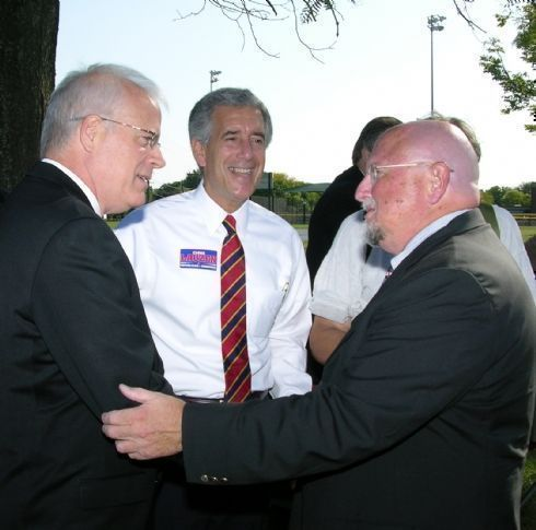 State Senator John Milner is greeted by Chris Lauzen and campaign supporter Dick Hawks prior to the campaign announcement.